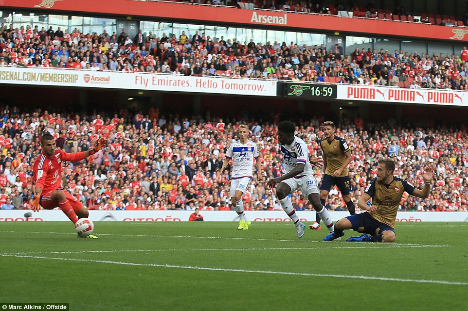Aaron Ramsey slides in to put Arsenal 4-0 ahead five minutes before half-time to round off an incredible spell for the Gunners