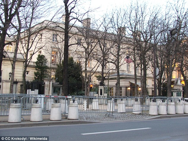 Crash: Police were setting up barriers for spectators to watch the final stages of the Tour de France by the US embassy (pictured) when the driver drove into them, leading officers to open fire on the car