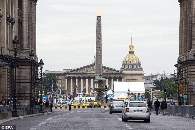 Locked down: Shots were fired at Place de la Concorde this morning before the final leg of the Tour de France