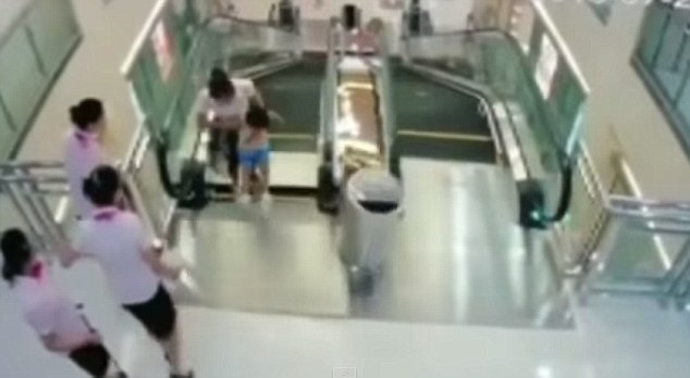 Shocking: The mother and her two-year-old son rode up the escalator together, but when they step off the escalator at the top, the floor gives way beneath them