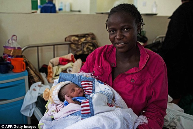Millicent Akinyo holds her new born baby girl, named 'Michelle' in honour of US First Lady Michelle Obama, at the Mbagathi Hospital in Nairobi