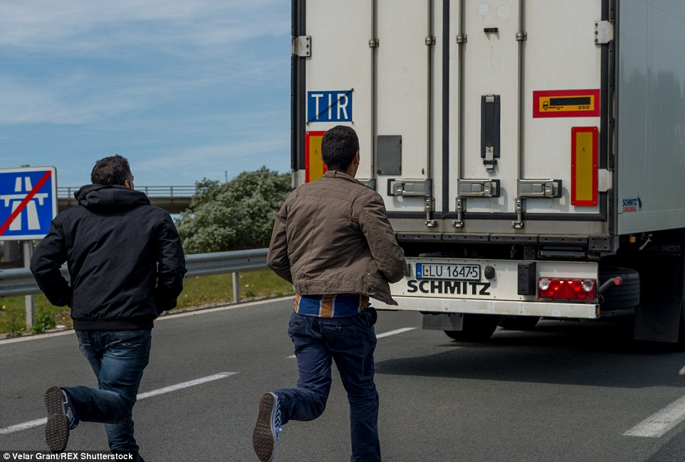 More than 2,000 migrants tried to force their way into the Channel Tunnel overnight, according to operator Eurotunnel, as more than 5,000 people camp out around Calais waiting for an opportunity to enter the UK. Above, migrants try to cross the Channel last week