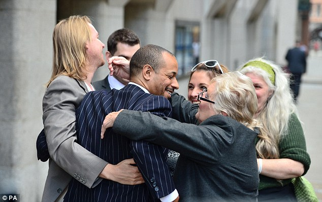 Mr Fellows celebrates outside court after the jury's verdict. He said he now intends the rebuild his life
