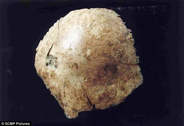 This piece of skull was found at the same site as the thigh bones in 2012. It is thought to belong to an early species of human that has been nicknamed Xuchang man. Researchers said it also bore the fossilised remains of a membrane that surrounded the brain, potentially providing insights into their nervous system