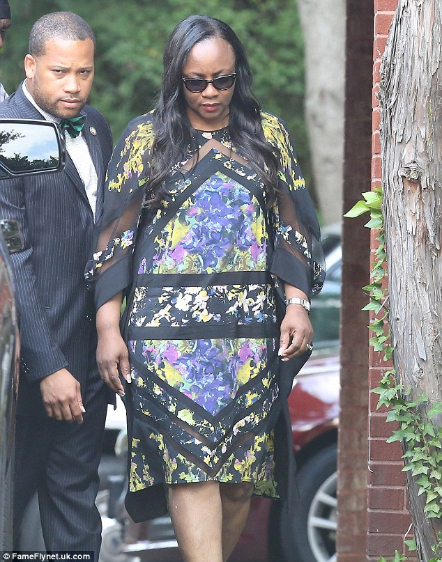Mourning: Pat Houston emerged looking solemn from Bobbi Kristina's wake in Georgia on Friday