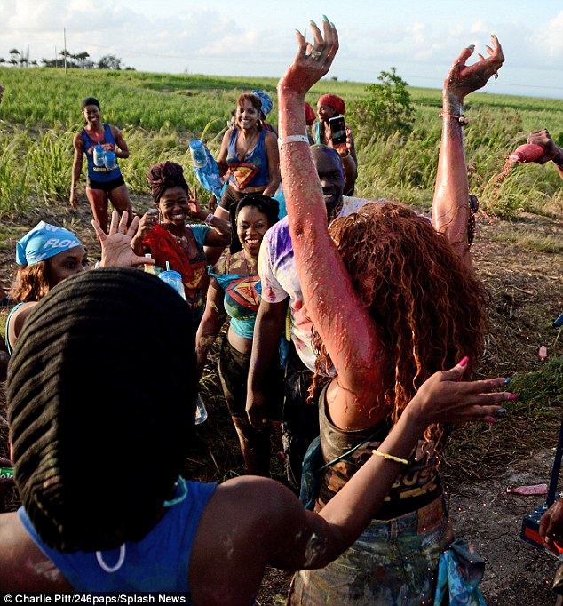 Proud: Several fellow Barbadians were happy to dance along with the A-list singer