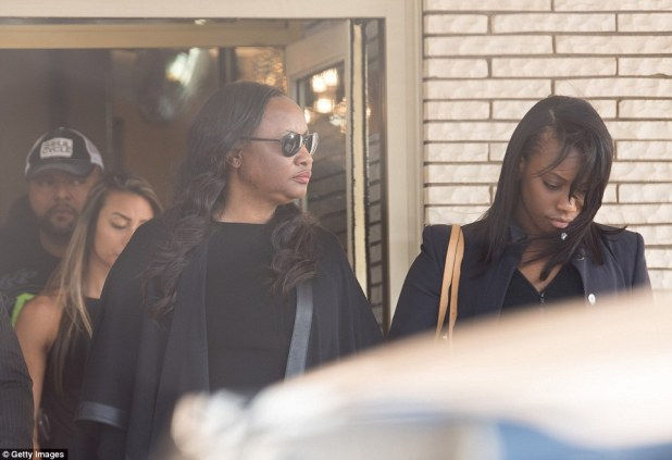 Pat Houston leaves the Whigham Funeral Home on Monday with her daughter Rayah following a service for Bobbi Kristina as they prepare to see the 22-year-old placed in the ground