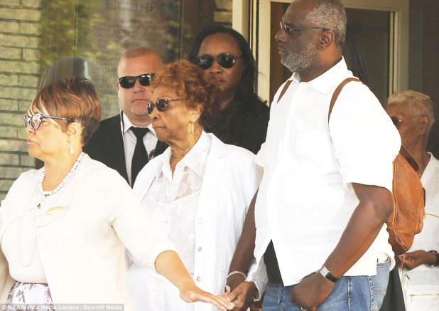 Cissy Houston, center, the grandmother of Bobbi Kristina Brown, looks on as the casket with Brown's body is placed into a hearse at the Whigham Funeral Home
