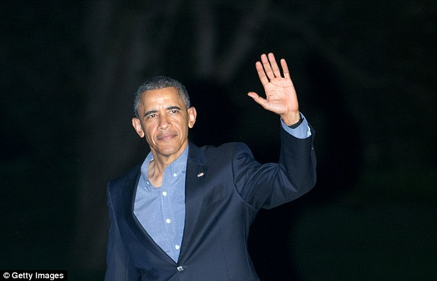 Where's it at?:President Obama was spotted without his weeding ring on multiple occasions over the past week (above on July 29)