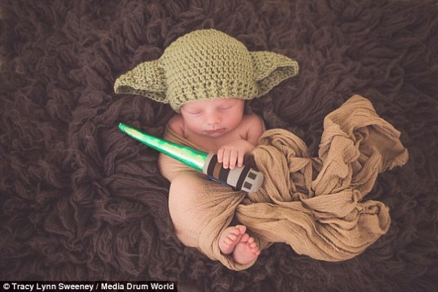 Sleeping newborn is dressed up as Yoda in homage to new Stars Wars     A Yoda baby has been captured in homage to the upcoming Star Wars movie by  photographer