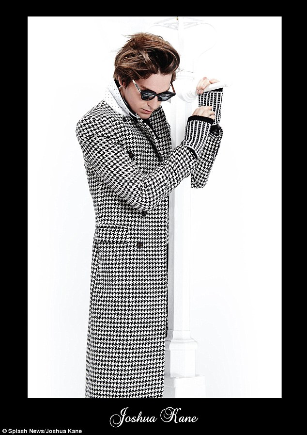 George Craig, also a Burberry model, poses in a houndstooth overcoat for the images
