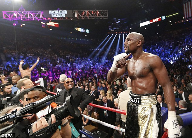 Mayweather celebrates his win over Pacquiao which extend his winning record to 48 without loss