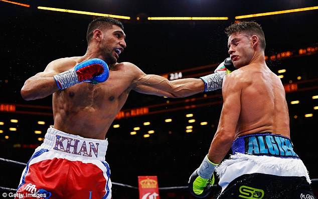 Khan punches Chris Algieri during their welterweight bout  in New York back in May, with the Brit once again snubbed by Mayweather for a potential clash