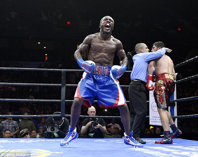 Berto (left) celebrates after knocking out Josesito Lopez in the sixth round during their March bout