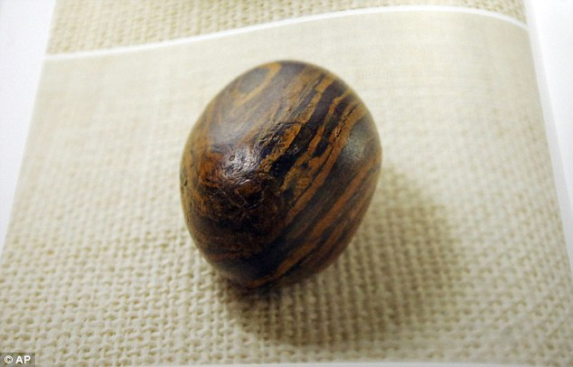 Seer stone: A picture of a smooth, brown, egg-sized rock is shown in the printer's manuscript of the Book of Mormon following a news conference on Tuesday at the Church of Jesus Christ of Latter-day Saints Church History Library, in Salt Lake City