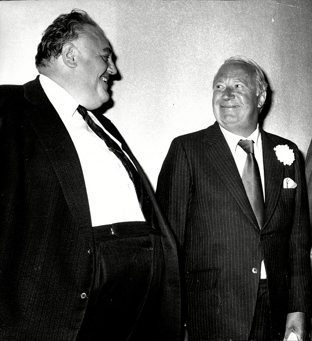 Link: Sir Edward Heath is pictured withpaedophile Cyril Smith, a former MP for Rochdale, in Leeds in 1975, who is known to have been a linchpin in the Westminster paedophile ring