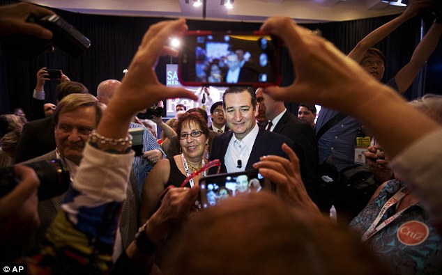 Supporters: Cruz, right, has his photo taken with Betsy Shaw Kramer, from Georgia, following his speech