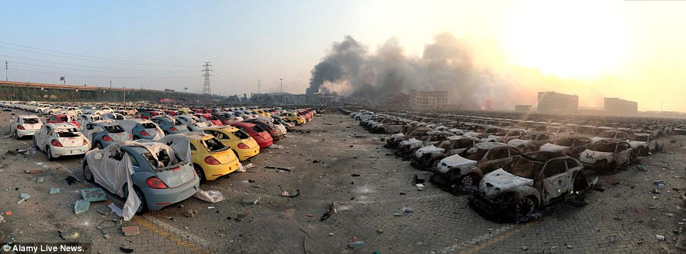 The enormous fireballs from the blasts rolled through a nearby parking lot, turning a fleet of 1,000 new cars into scorched metal husks