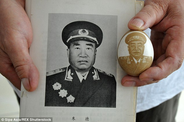 Zhu De featured in the egg shell carving by Li, above, was one of the pioneers of the Chinese Communist Party