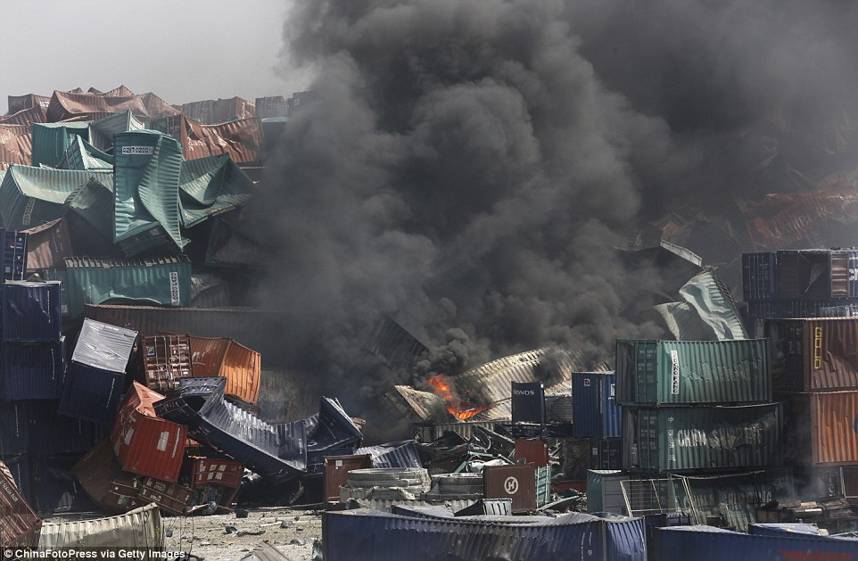 Still going: Fire and smoke at the site of the explosion that saw at least 50 people killed and more than 700 were injured
