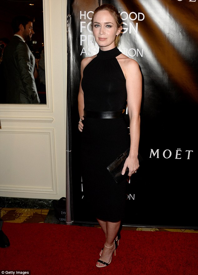 LBD: The 32-year-old actress cloaked her curves in a knee-length black dress that cinched in at the waist with a leather belt