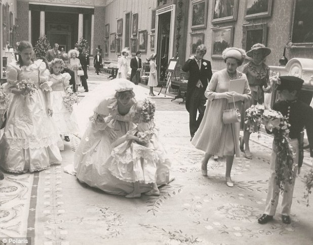 'One of the previously unseen 'out-takes' from the wedding album of Prince Charles and Princess Diana, to be auctioned in the U.S. next month, it shows the new Princess holding a small blonde bridesmaid in her arms. I love the picture's spontaneity and tenderness'