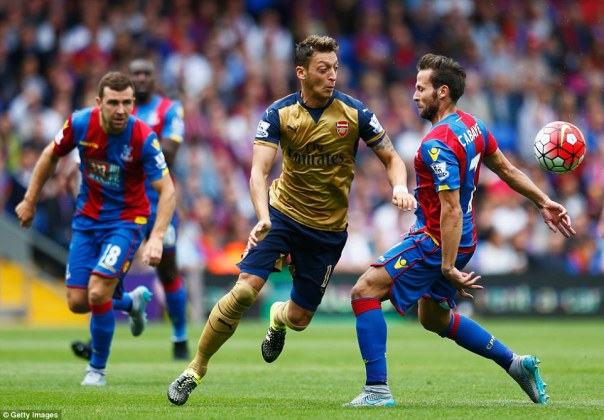 Crystal Palace summer signing Cabaye attempts to close down Arsenal playmaker Mesut Ozil during the first half of the league contest