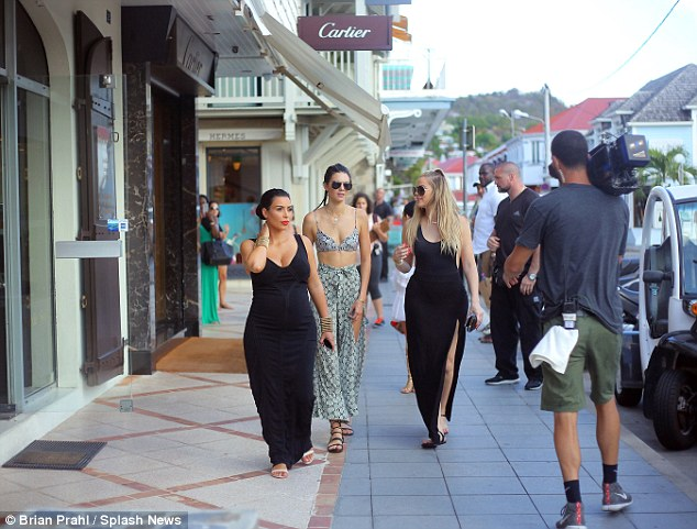 Rolling: Surrounded by security crew and cameramen, the reality stars appeared relaxed as they were filmed