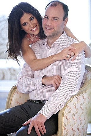 Noel Biderman, CEO of Avid Life Media with his wife Amanda (pictured together)