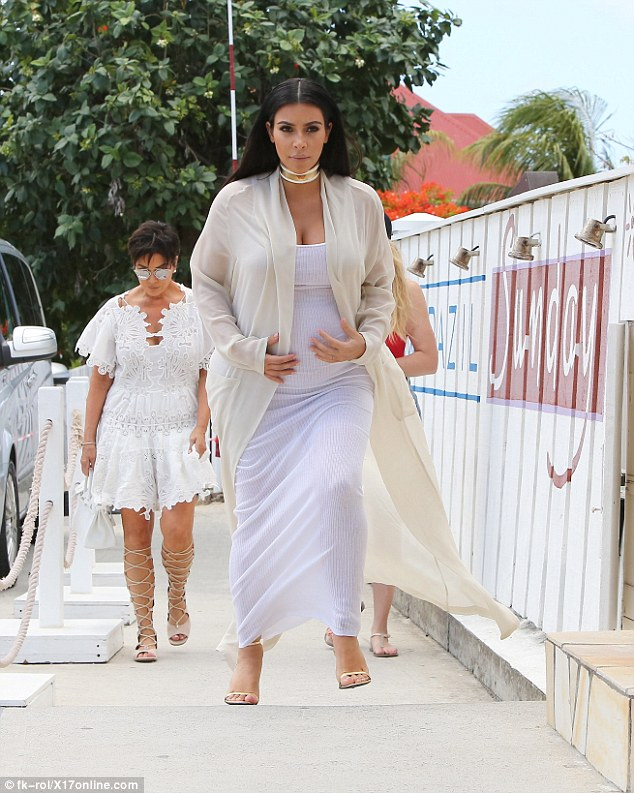 Another beach day: Kim Kardashian was spotted keeping a protective hand on her pregnant stomach while heading to lunch with her family in St Barts as Kris Jenner followed close behind on Wednesday