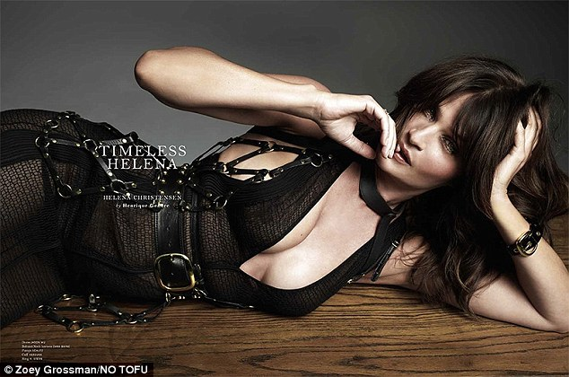 So seductive: The mother-of-one exposes her cleavage as she slips her enviable body into a semi-sheer and buckle-detail garment
