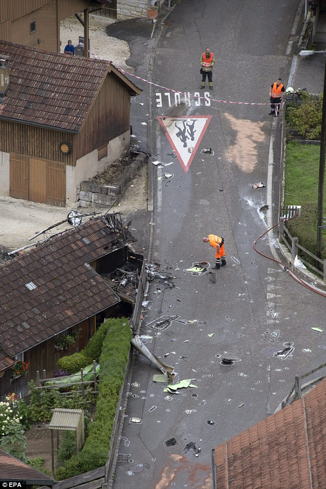 Emergency response: Debris covers the road in Dittingen where one of the planes came down earlier today