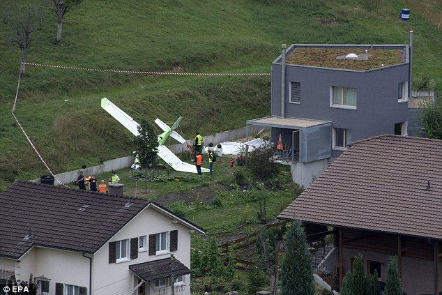 Crash site: The pilot of the second plane managed to escape by parachute and his aircraft crashed close to a house on the edge of the village