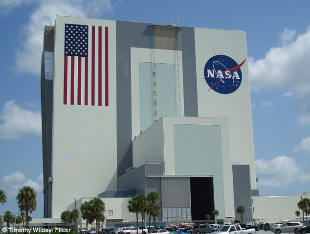 An investigation by Daily Mail Online has revealed staff members working for NASA purchased child pornography from Eastern Europe, but avoided prosecution. Pictured is the vehicle assembly building at the JFK Space Center at Cape Canaveral, Florida
