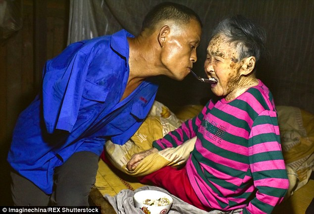 Chen Xinyin (left) has been feeding his mother (right) since she became ill especially after becoming paralysed