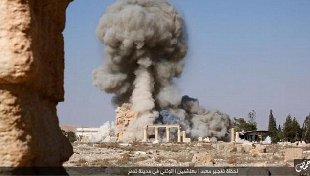 Blast: Smoke rises from theBaalshamin temple after ISIS militants filled it with explosives and detonated them in the ancient wonder