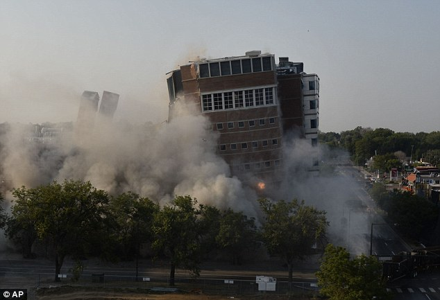 The old University of Colorado Health Sciences Center on East Ninth Avenue was imploded at 8am in Denver