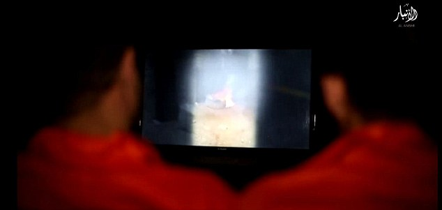 Painful: The victims were forced to watch videos of Shi'a paramilitary forces burning ISIS corpses