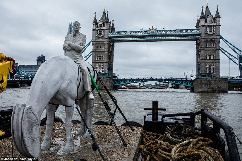 Proud: The Rising Tide sculpture, free to view from the riverside walkway on London's South Bank for up to two hours either side of low tide, is pictured her being installed against the backdrop of Tower Bridge