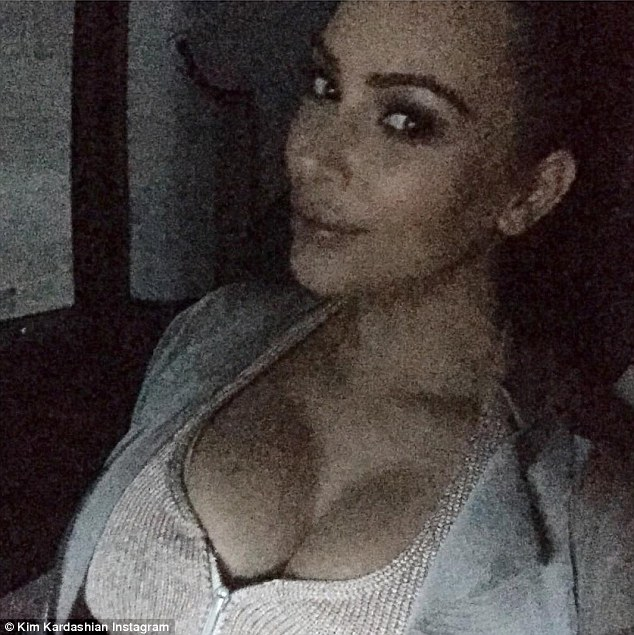 Social media milestone: Kim Kardashian shared a pair of grainy selfies on Wednesday to mark reaching 45 million followers on Instagram