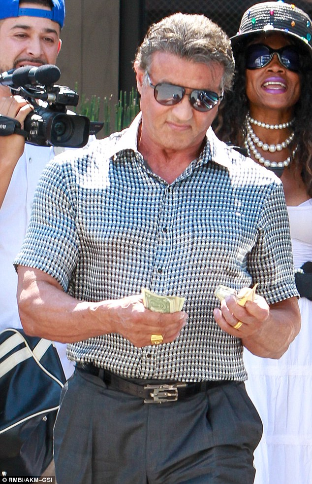 Sylvester Stallone Flashes Wad Of Cash After Lunch In