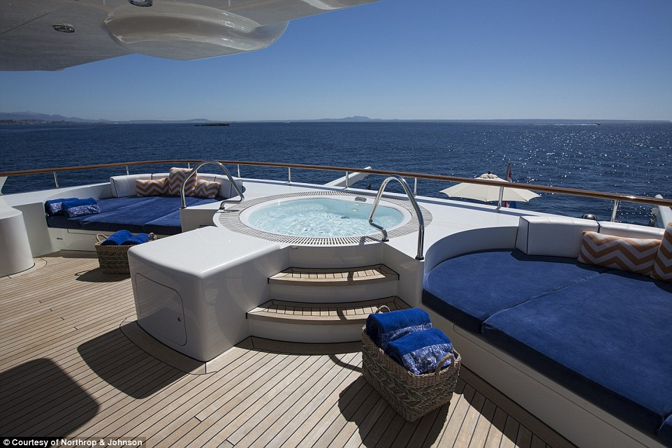 The tri-deck vessel accommodates 10 guests in five staterooms, and has a spacious sun deck with a hot tub and bar