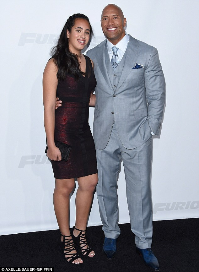 Proud papa: The former pro wrestler has remained close to his daughter, now 14, and often brings her along to his movie premieres, like this one in LA in April for Furious 7