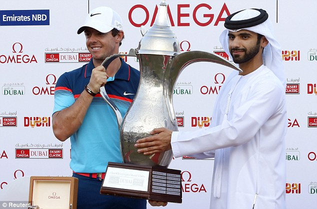 Sports fan: Rory McIlroy of Northern Ireland is presented with the trophy by His Highness Sheikh Mansoor Bin Mohammed Bin Rashid Al Maktoum after the final round  of the Dubai Desert Classic earlier this year. Three days of mourning have been announced after his death at 33