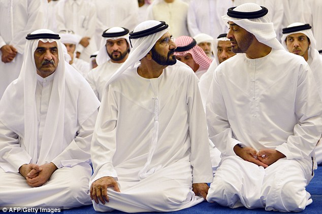 Sheikh Mohammad bin Rashid al-Maktoum (middle) Prime Minister of the United Arab Emirates has a quiet word withSheikh Mohamed bin Zayed Al Nahyan (R), Crown Prince of Abu Dhabi (right)