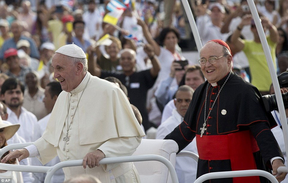 Cuba's Cardinal Jaime Ortega, right, stands behind Pope Francis in the popemobile ahead of the Mass. Ortega, who was among many priests sent to military-run agricultural camps in the 1960s after Fidel Castro declared Cuba to be socialis, thanked the pope for his work promoting detente between Havana and Washington and called for reconciliation
