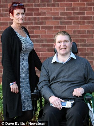Corporal Simon Vaughan with his mother and carer Lynne Baugh outside Telford County Court today