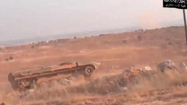 On his way: The video shows Tayyar driving the vehicle off into the distance where he blows himself up