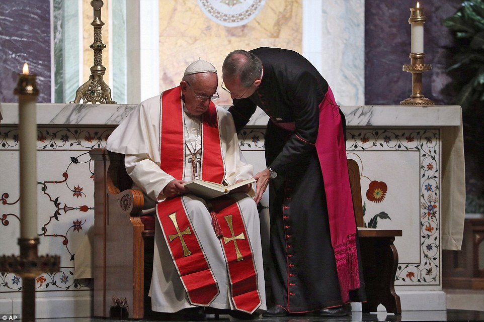 Pope Francis read in Latin as he held the Midday Prayer Service at the Cathedral of St Matthew in Washington, before about 300 American bishops