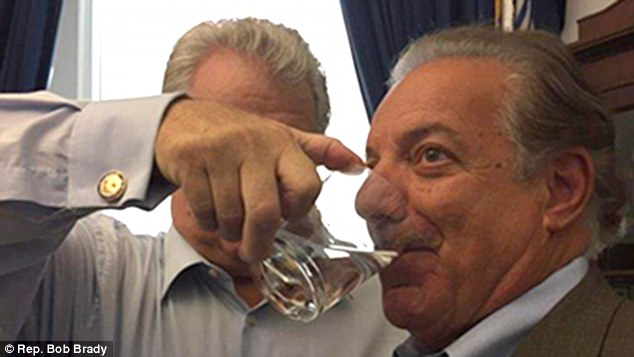 Messiah:Brady poured the liquid into the mouths of others rather than letting them hold the glass and had his staff send out the photos (above with constituent Ernie DeNofa)